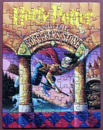 Harry Potter Book 1 by Mary GrandPre - NY Puzzle Co. - 100 pieces